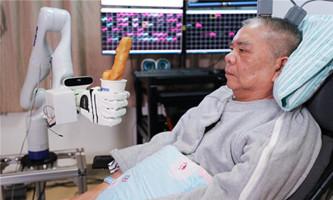 Implants give paralyzed man's brain new control